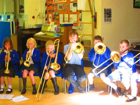 Elm learning Brass instruments.