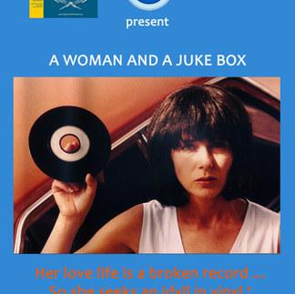 A woman and a juke box