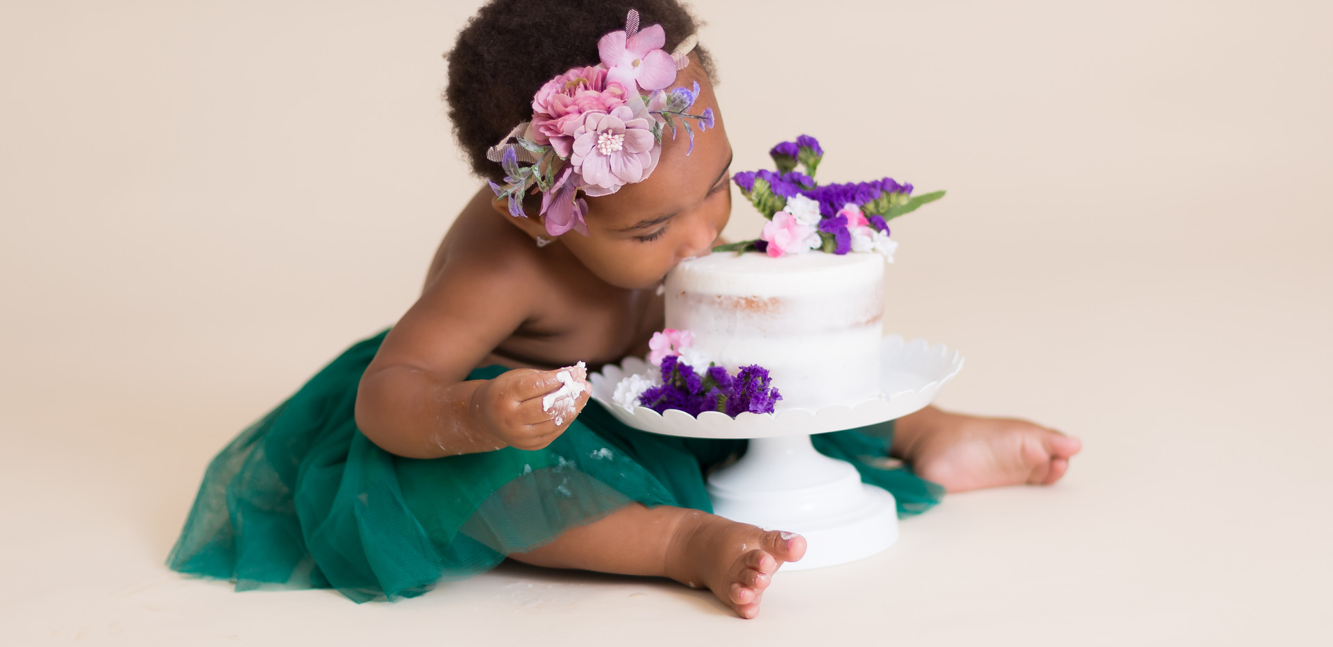 baby girl eating birthday cake, Chattanooga cake smash photographer