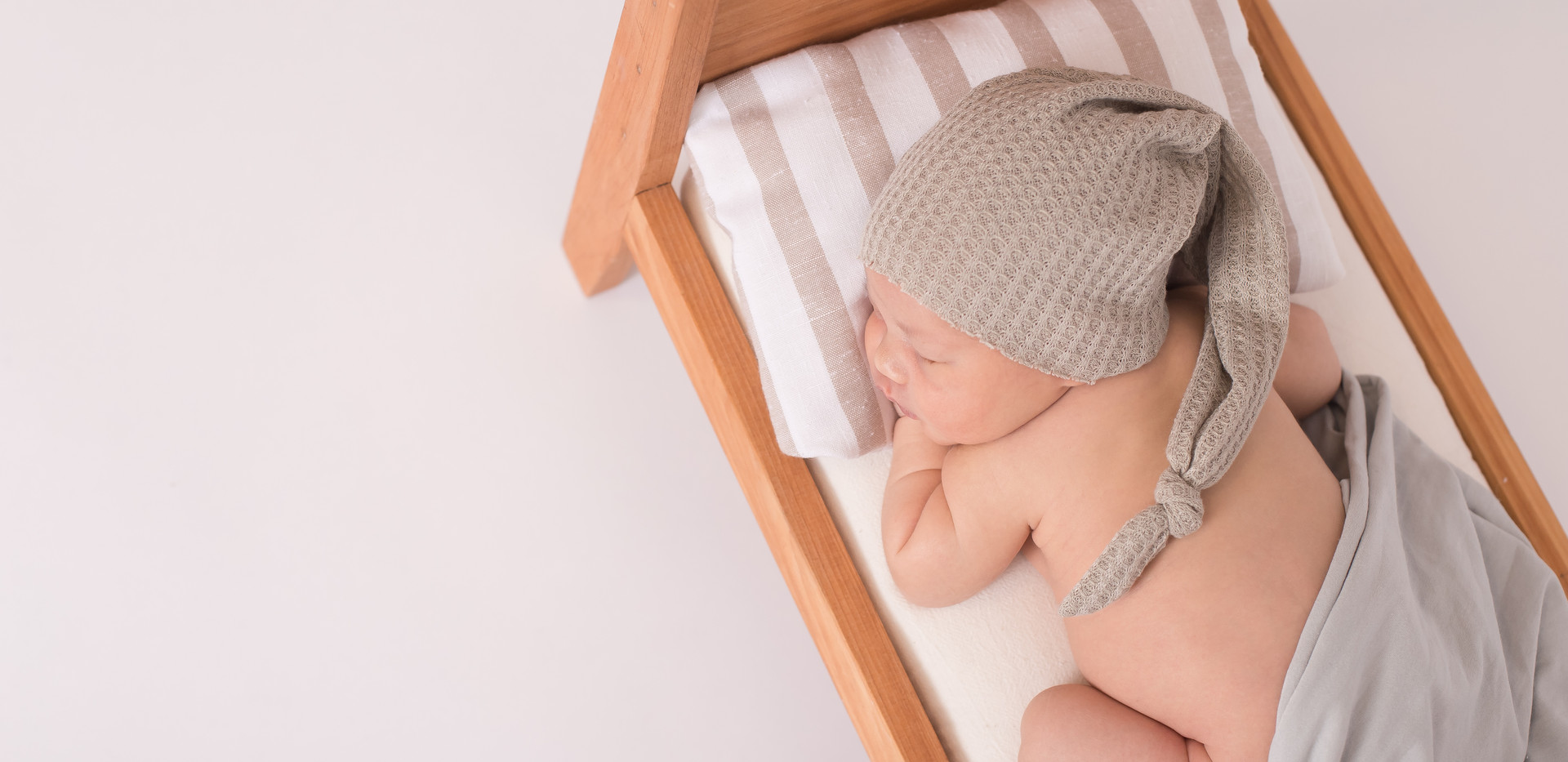 baby sleeping in doll bed, newborn photos Chattanooga