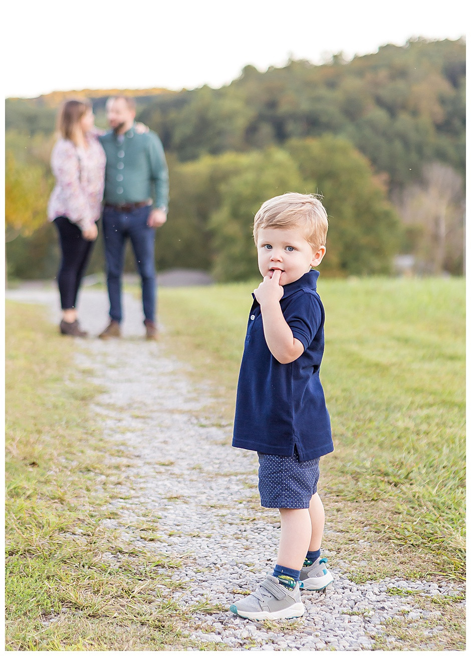 child with parents, family photographer Chattanooga Tennessee, gravel, baby photographer Chattanooga