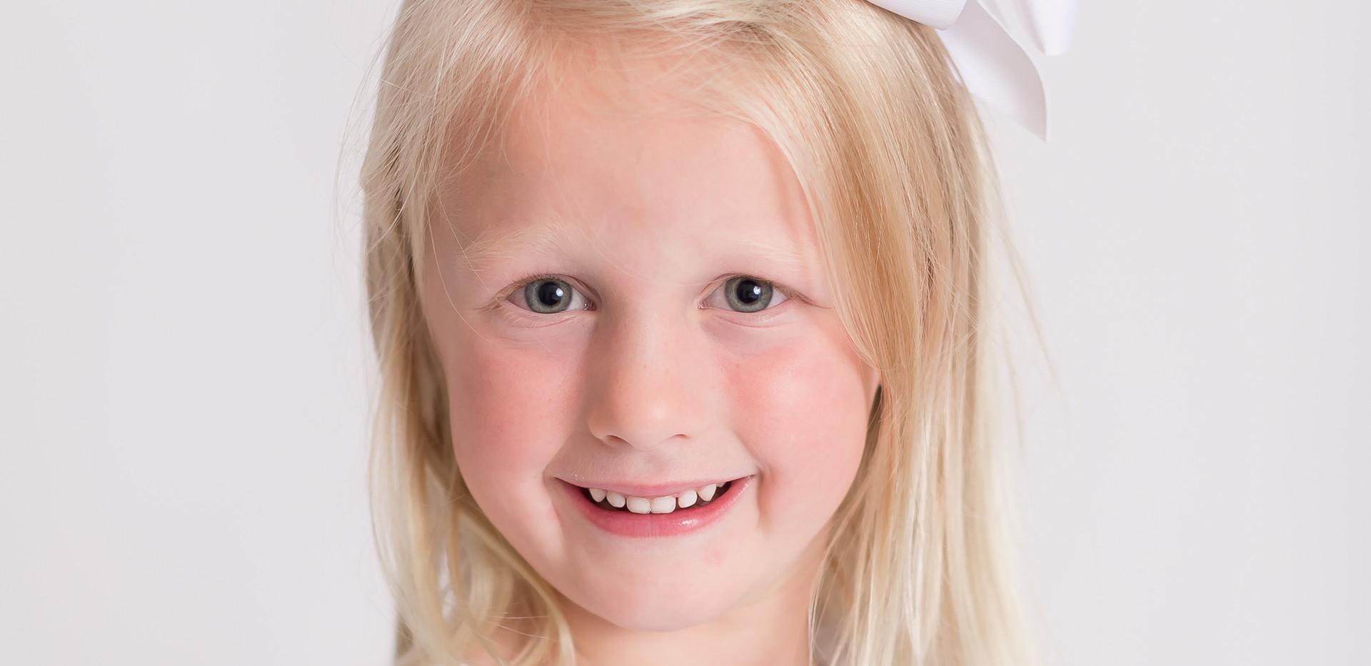 blonde girl smiling, family photographer Chattanooga