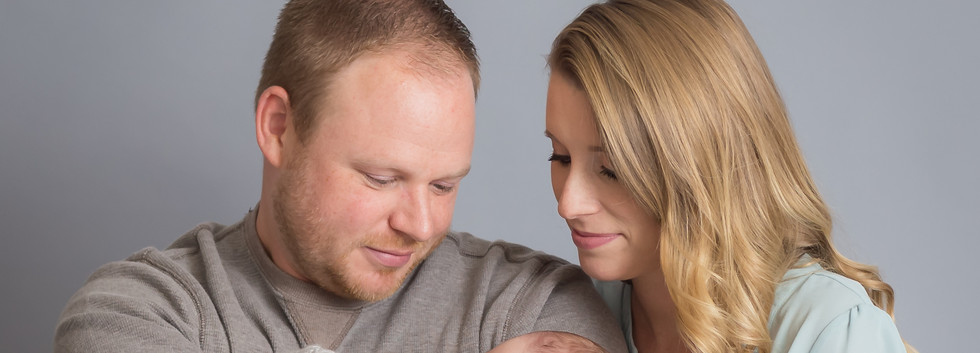 young family with baby, newborn photographer Chattanooga