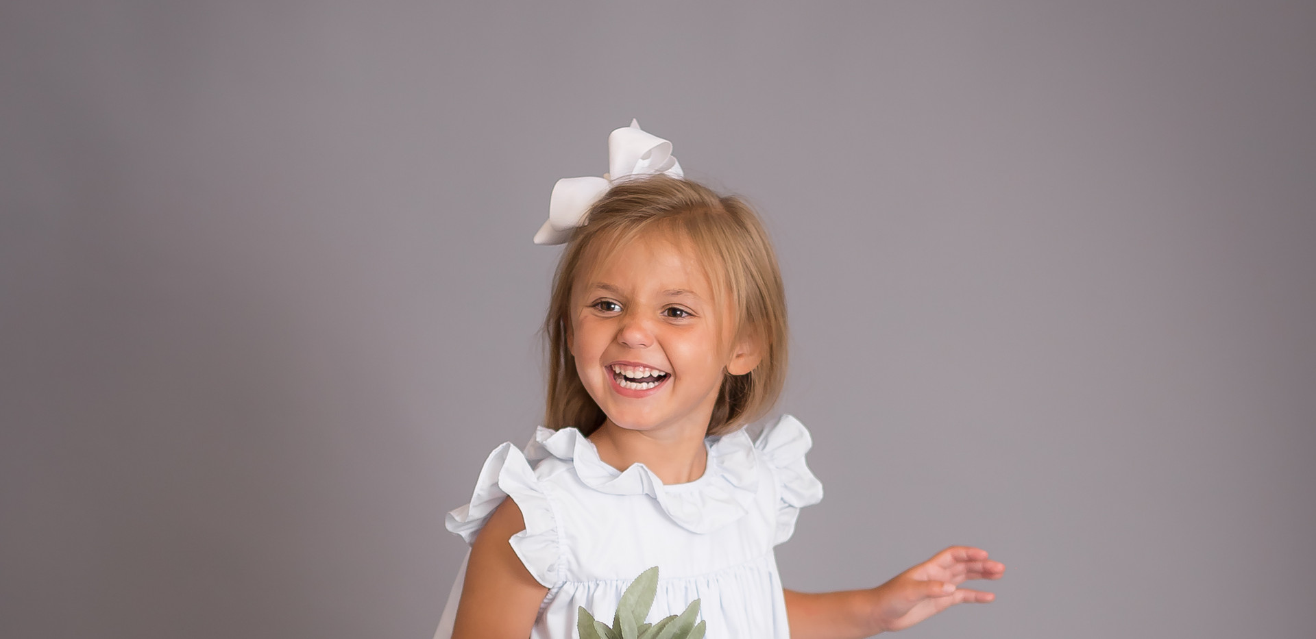 girl laughing with flowers, Chattanooga photographer