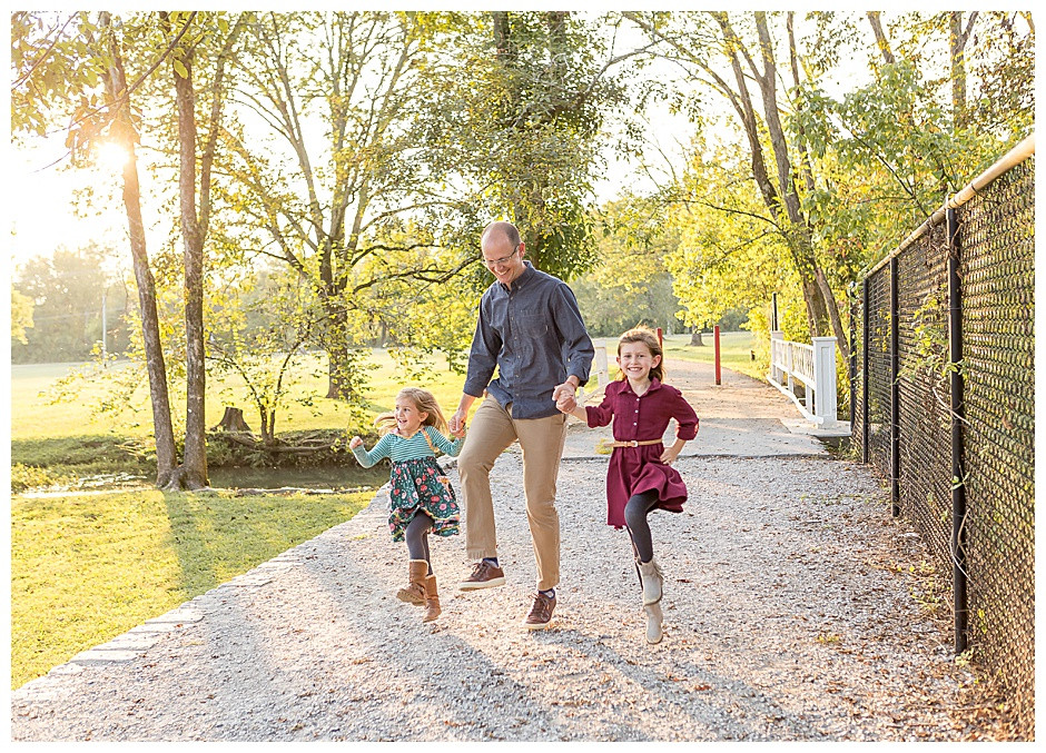 dad skipping with daughters, best family photographer Chattanooga