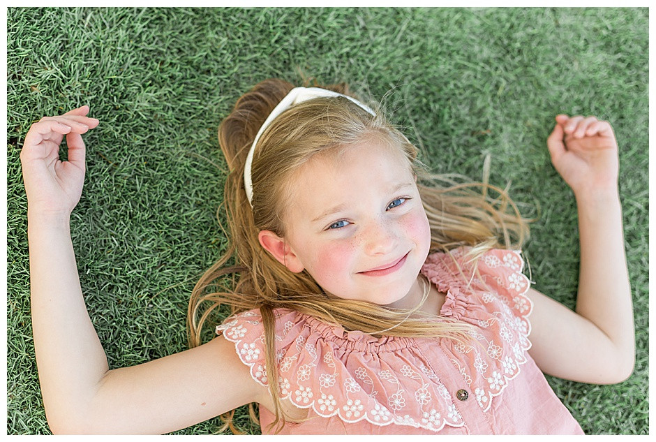 girl laying in grass, family photographer chattanooga