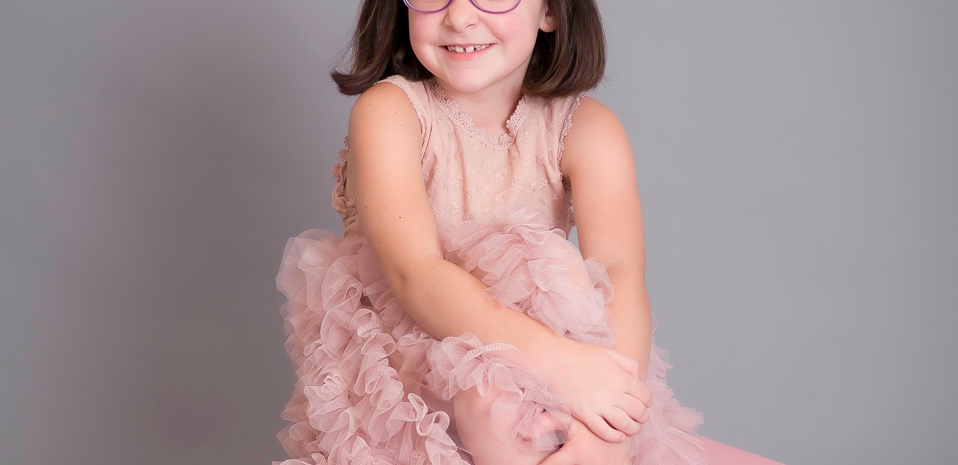 Chattanooga photo studio, girl in pink dress smiling