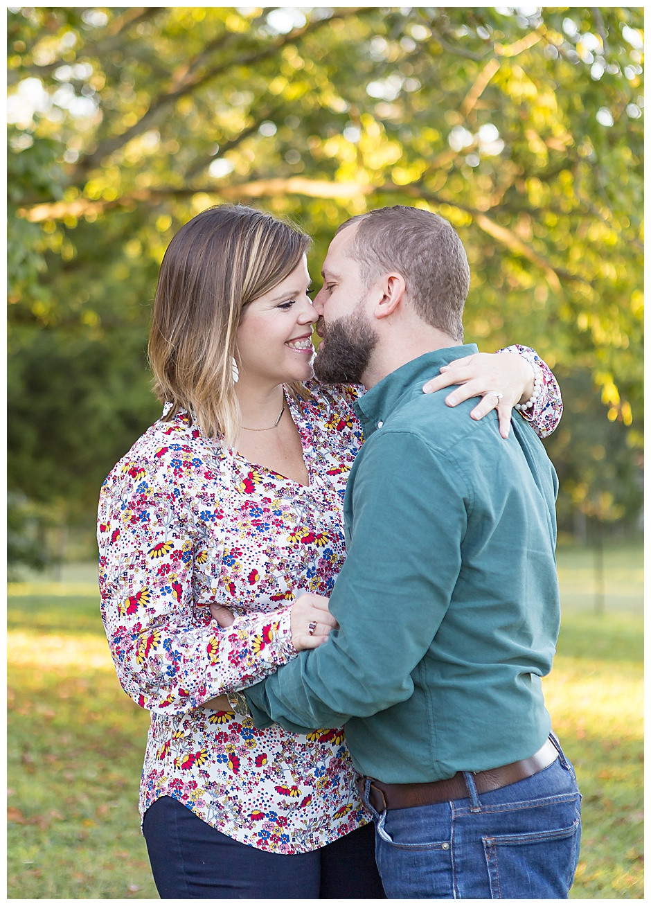 family photographer Chattanooga, maternity photos Chattanooga, kiss, fall trees
