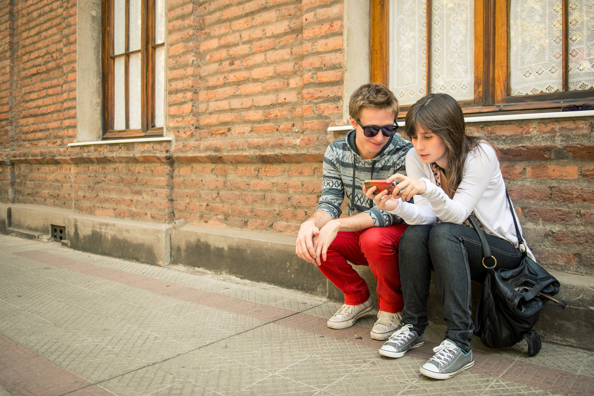 Young urban couple sharing information