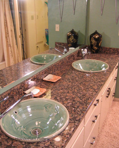 Inset-Style Celadon Green Sinks in granite countertop