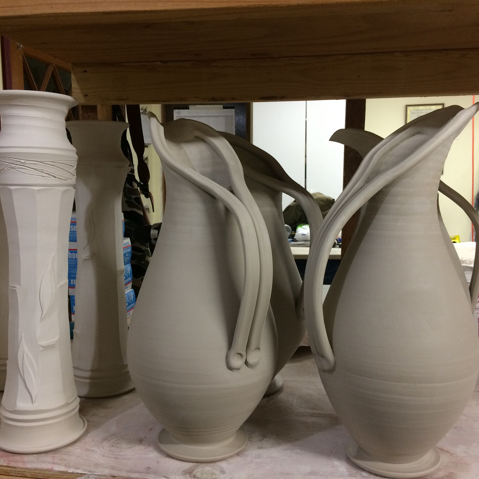 Penguin Pitchers drying for initial bisque firing