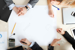 39878823-top-view-at-business-people-at-office-desk-Stock-Photo-meeting