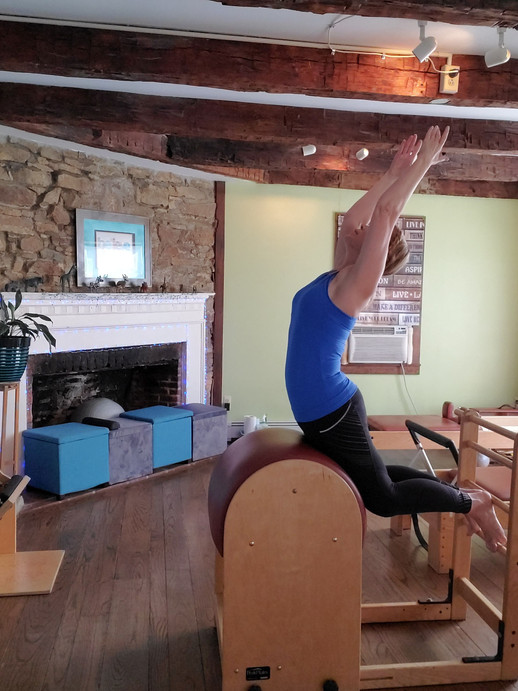 Michelle doing Swan on the Pilates Ladder Barrel