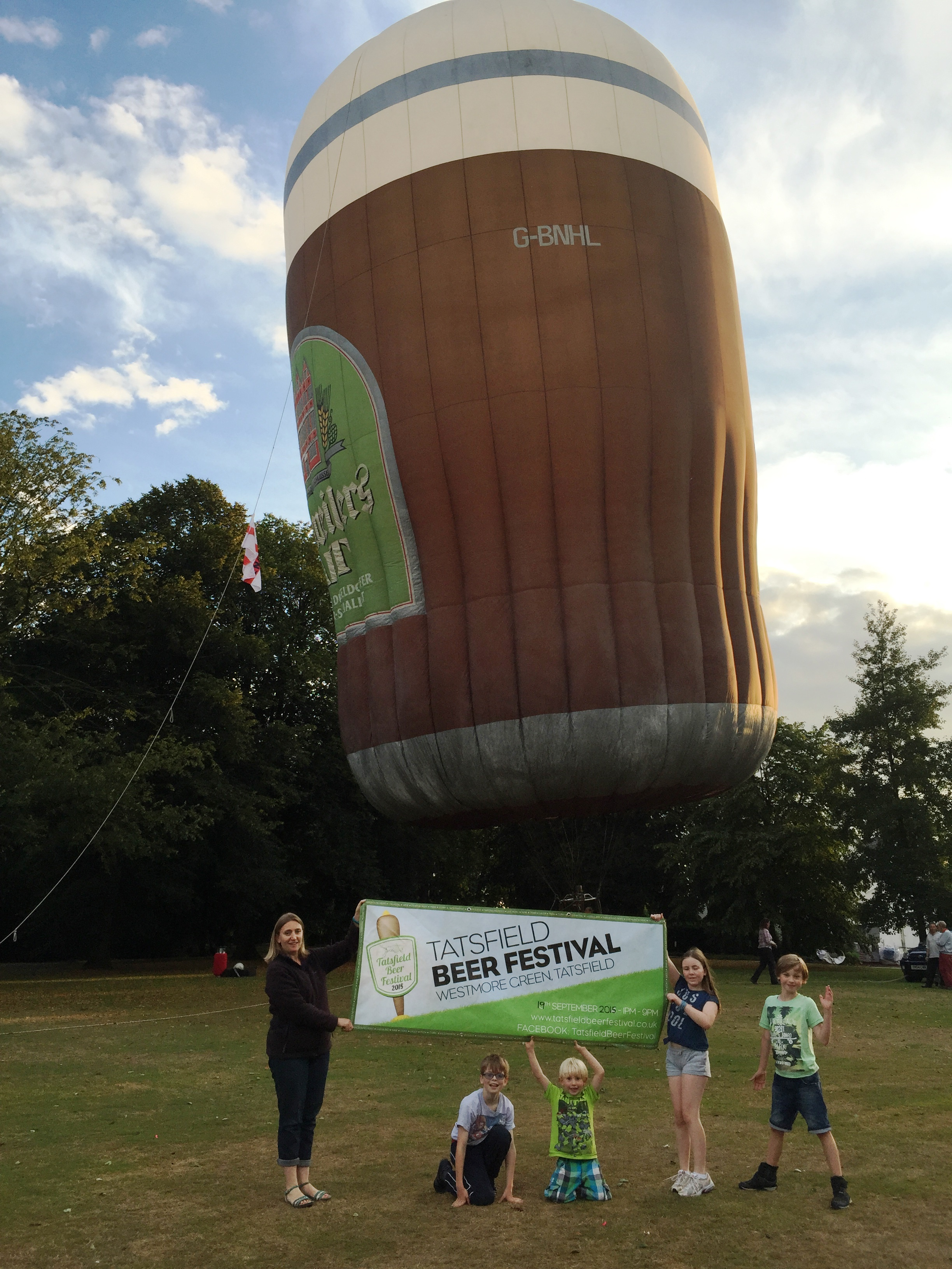 Amanda, Noel, Charlie, Zoe and Finley with giant beer hot air balloon, Tatsfield Village Green