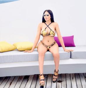 Dencia poses in Versace