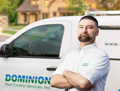 Dominion Pets Control worker with service truck.