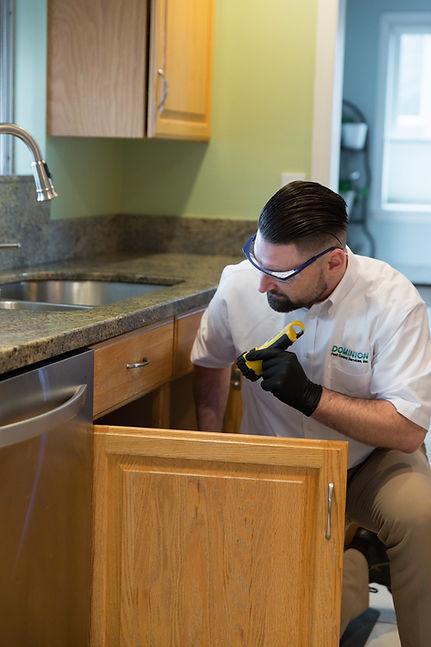pest control expert examining a home.