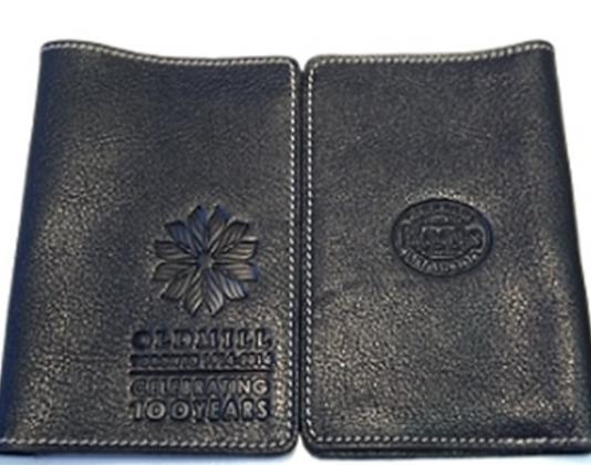 A PASSPORT HOLDER CELEBRATING 100 YEARS (BLACK)
