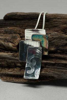pendant silver patina texture