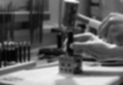 black and white silversmithing studio dapping block hammer