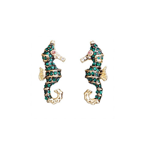 Emerald green sea horse earrings.