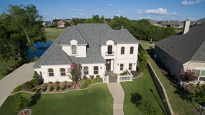 Drone photo of a palatial house located on Bison Meadow Lane, Heath, Texas
