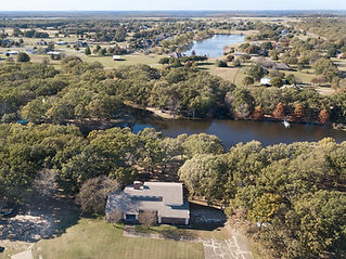 Drone photo of a house with two ponds behind it