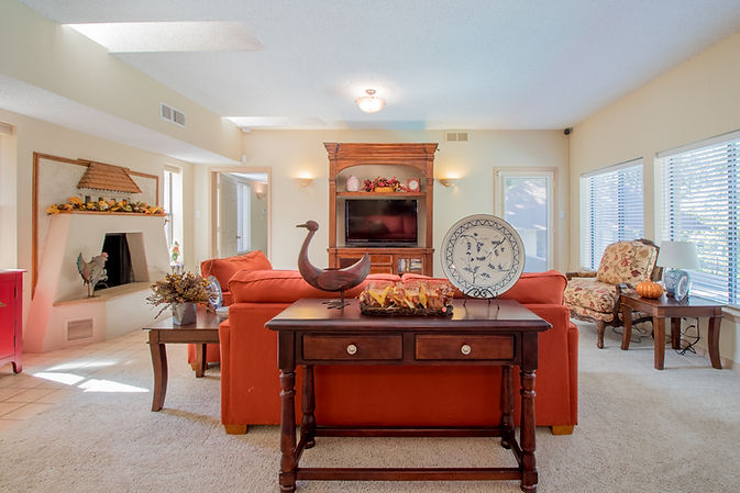 Tastefully decorated Livingroom featuring Fireplace and TV Cabinet