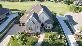 Drone photo of a house overlooking the second hole of Buffalo Creek Golf Course in Heath, Texas