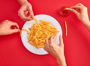 young-woman-eating-french-fries-potato-w