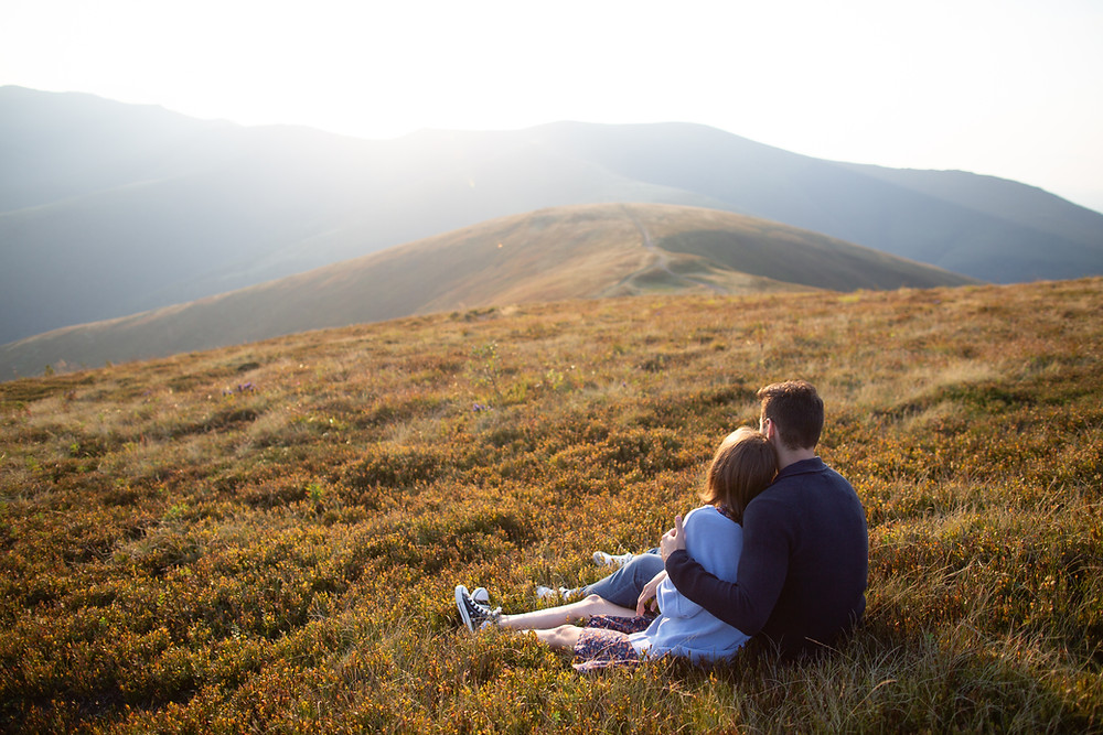 couple watching the sunset on a mountain