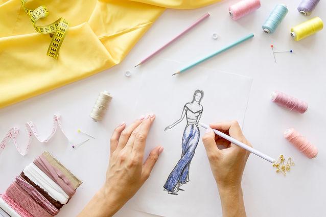 top-view-woman-designing-garment-sew.jpg