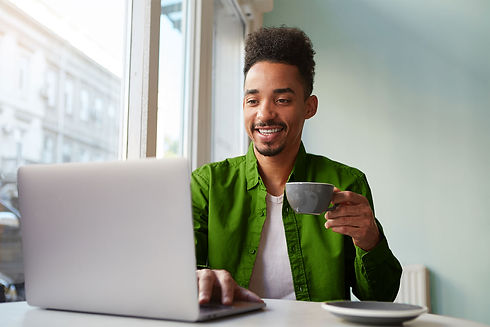 african-american-guy-sitting-table-cafe-