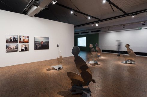 Installation view with works by (clockwise):
