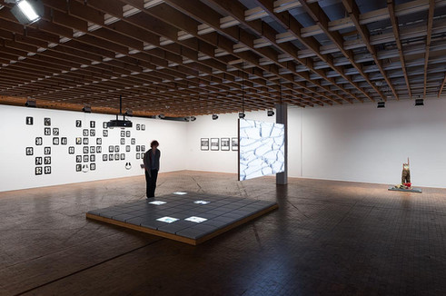 Installation view with works by (left to right):