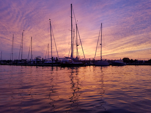 Sunset on the water, sailboat