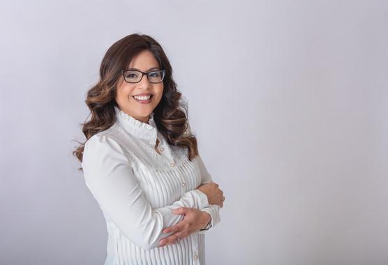 Headshot of a women on white background