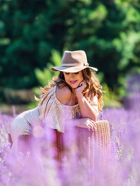 Girl in sequin dress in lavendar field