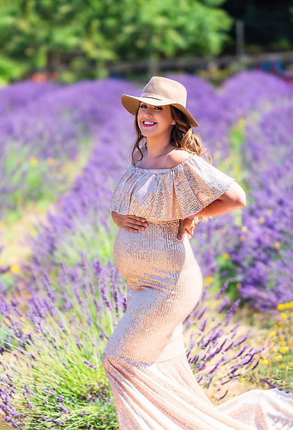 Beautiful pregnant girl in champage sequen maternity dress