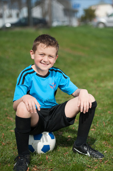 Boy on soccer ball