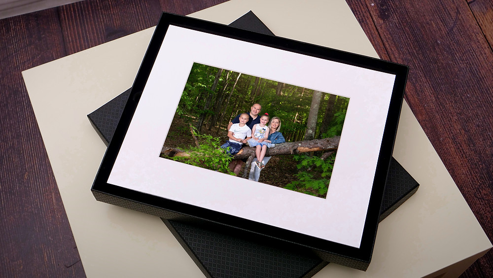 Family prints in a folio box