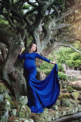 Pregnant girl in a blue maternity gown