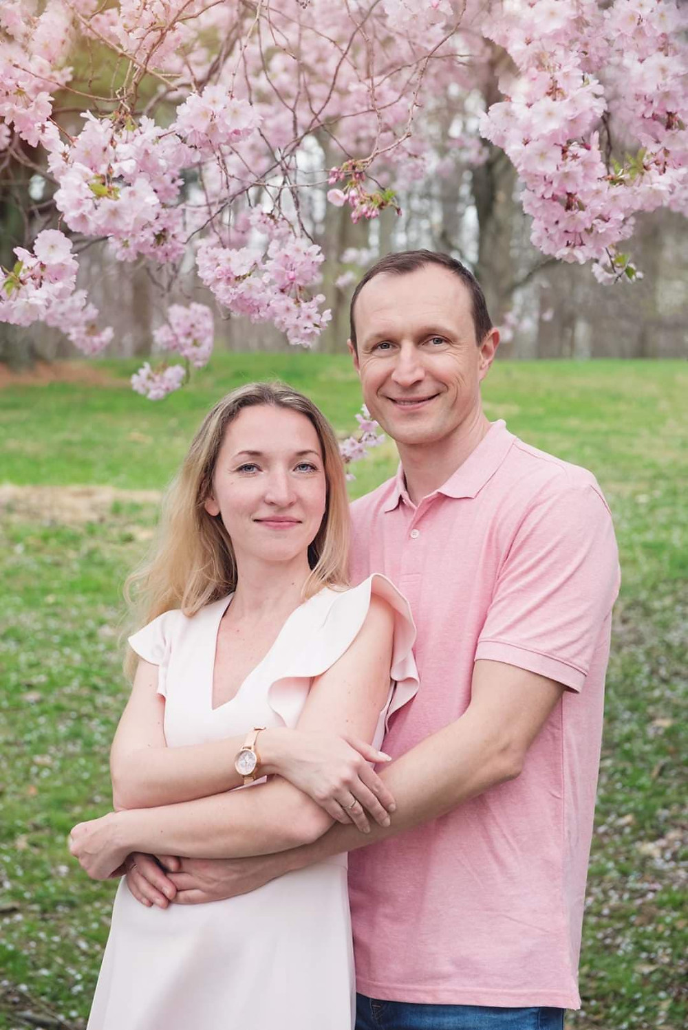 A New Jersey couple with Cherry Blossoms in Holmdel Park. Cherry Blossoms Family Photoshoot
