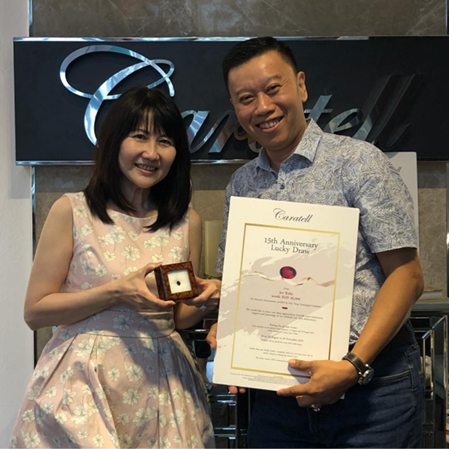 Joyce Sim, winner of the 3ct ruby, and Caratell's Michael Koh
