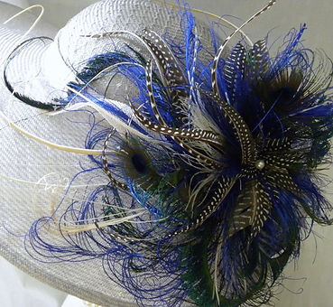 Wide brimmed hat with feathered decoration , in blues and grays, Large fluid like, $315.00