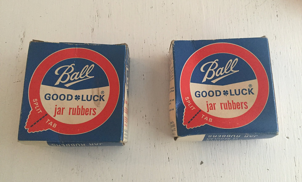Two vintage ball 'good luck jar' rubbers