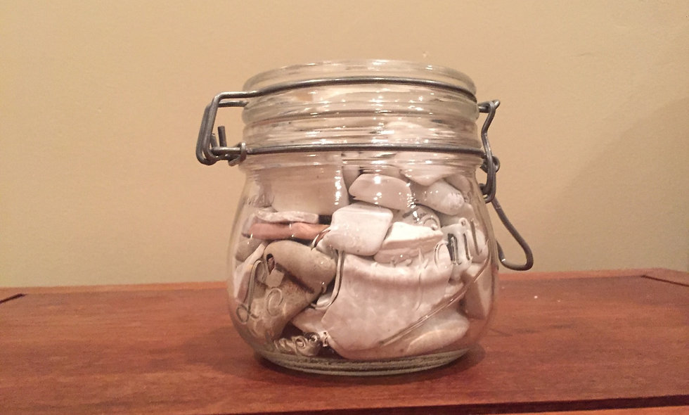 vintage jar with beach pottery