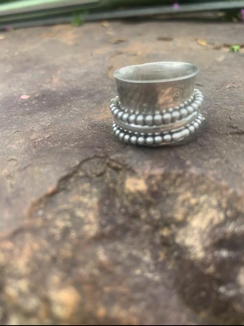 All silver spinner ring