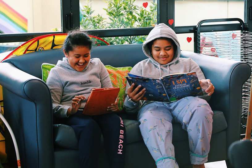 teenagers reading in their humble hoodies