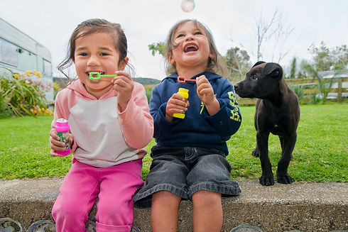 friends blowing bubbles together